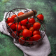 Cherry tomatoes on green background - PhotoDune Item for Sale