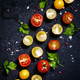 Food background: red, yellow and orange cherry tomatoes, black background - PhotoDune Item for Sale