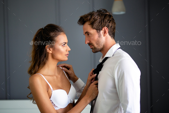 Sensual foreplay by couple in bedroom. Passion, desire, romance concept - Stock Photo - Images