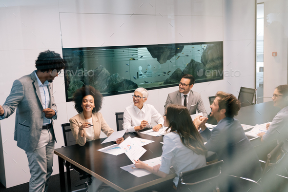 Portrait of successful business team working in office - Stock Photo - Images