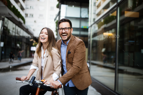 Happy smiling young couple having fun in the city - Stock Photo - Images