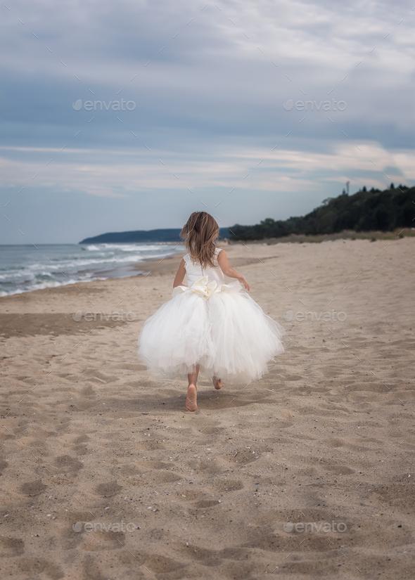 Girl on a sandy beach - Stock Photo - Images
