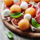 Healthy appetizer with melon, ham and mozzarella - PhotoDune Item for Sale