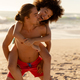 Multi-ethnic couple having fun on the beach - PhotoDune Item for Sale