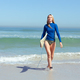 Caucasian woman during surf session at beach - PhotoDune Item for Sale