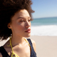 Mixed race woman standing on the beach - PhotoDune Item for Sale