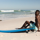 African American man and surf board on the beach - PhotoDune Item for Sale