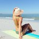 Caucasian woman enjoying at beach - PhotoDune Item for Sale