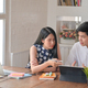 Young men and young women are using laptop and helping to make reports. - PhotoDune Item for Sale
