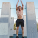 Young athletic man doing burpee on parkour area. Training alone outdoors. - PhotoDune Item for Sale