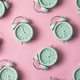 Creative layout of green alarm clock's on pastel pink background. Minimal concept. - PhotoDune Item for Sale