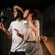 Young attractive man and woman joyfully singing together in modern sound recording studio - PhotoDune Item for Sale