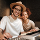 Cheerful musicians happily looking in camera recording song on piano keyboard for new music album - PhotoDune Item for Sale