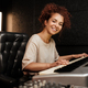 Young attractive woman happily looking in camera playing on electric piano in sound recording studio - PhotoDune Item for Sale