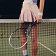 Sexy female tennis player posing on a tennis court. - PhotoDune Item for Sale