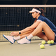 Female tennis player posing on a ground in a court. - PhotoDune Item for Sale