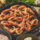 Tasty appetizing roasted shrimps prawns with spices on pan with ingredients on rusty background - PhotoDune Item for Sale
