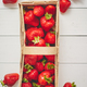 Wooden container with fresh red strawberries. Placed on white table - PhotoDune Item for Sale