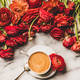 Cup of espresso coffee or cappuccino and ranunculus flowers - PhotoDune Item for Sale