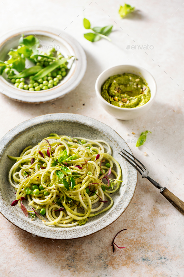 Zucchini pasta with peas and micro green sprouts - Stock Photo - Images