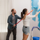 Young couple painting the wall - PhotoDune Item for Sale