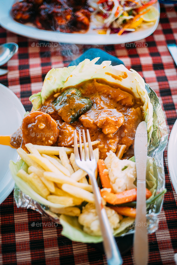 Goa, India. Dish Of Indian National Cuisine Is Sizzler, Which Consist Of French Fries, Fried Shrimp - Stock Photo - Images