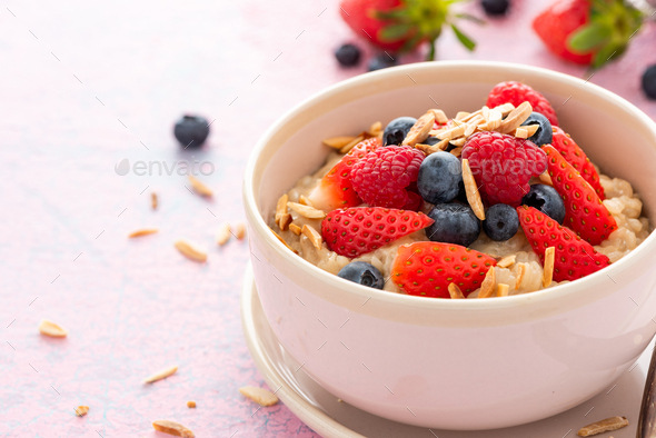 Porridge with Fresh Berry Fruits. Healthy Breakfast - Stock Photo - Images
