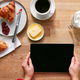 Overhead Flat Lay Of Woman With Digital Tablet On Table Laid For Breakfast With Croissant And Coffee - PhotoDune Item for Sale