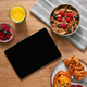 Overhead Flat Lay Of Digital Tablet On Table Laid For Breakfast With Cereal And Pastries - PhotoDune Item for Sale