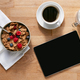 Overhead Flat Lay Of Digital Tablet On Table Laid For Breakfast With Cereal And Coffee - PhotoDune Item for Sale