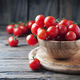 Red sweet tomatoes on the wooden table - PhotoDune Item for Sale