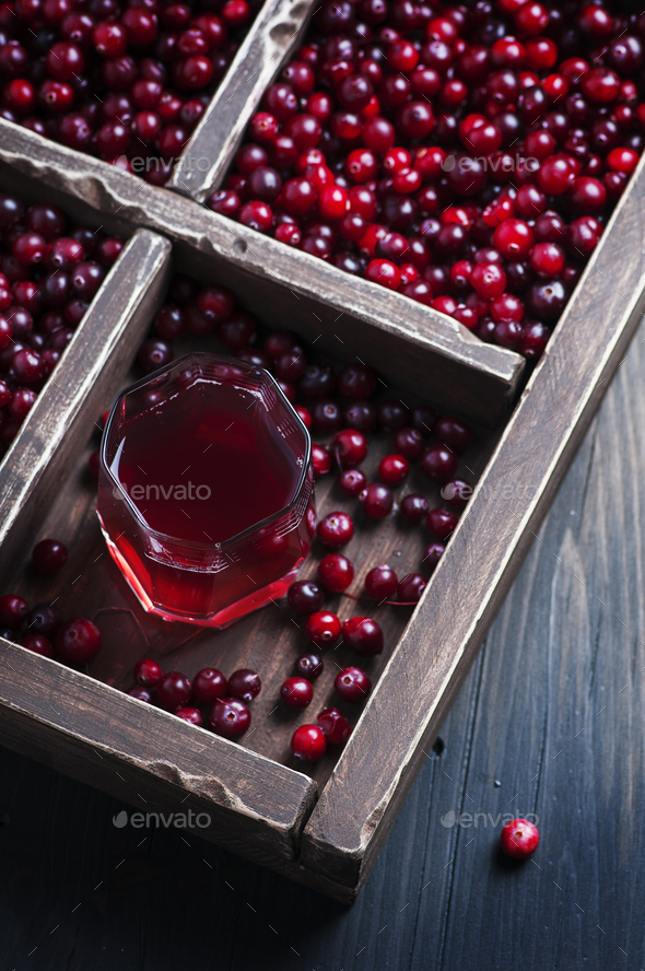Fresh cranberry juice on the wooden table - Stock Photo - Images