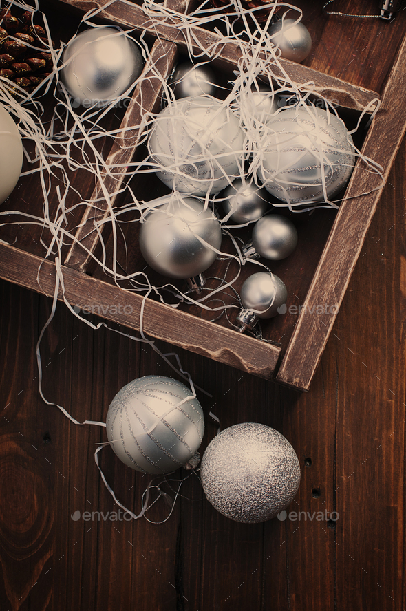 Christmas balls and cones in the wooden vintage box - Stock Photo - Images