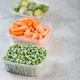 Frozen vegetables such as green peas, brussels sprouts and baby carrot in the storage boxes - PhotoDune Item for Sale
