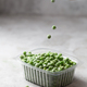 Mans hand holds peas in the storage box on the kitchen table, vertical orientation - PhotoDune Item for Sale