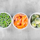 Frozen vegetables such as green peas, brussels sprouts and baby carrot in the white bowls - PhotoDune Item for Sale