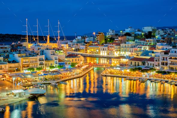 Beautiful Agios Nikolaos town at night. Lasithi region of Crete island, Greece - Stock Photo - Images
