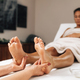 Enjoying Foot Massage Treatment in a Wellness Center - PhotoDune Item for Sale
