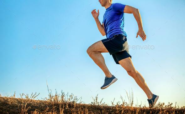 athlete runner run uphill - Stock Photo - Images