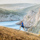 middle-aged man running uphill on trail - PhotoDune Item for Sale