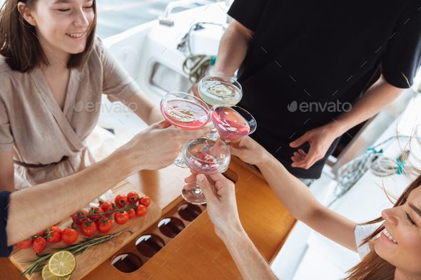 Top view group of happy friends drinking vodka cocktails at boat party outdoor, cheerful and happy - Stock Photo - Images