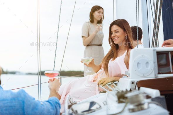 Happy smiling woman drinking vodka cocktails at boat party outdoor, cheerful and happy - Stock Photo - Images