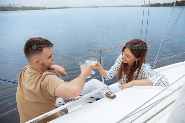 Happy couple drinking vodka cocktails at boat party outdoor, cheerful and happy - Stock Photo - Images
