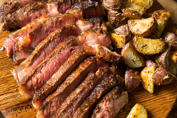 Grass Fed Ribeye Steak and Potatoes - Stock Photo - Images