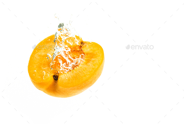 Fresh apricot falling in water splash. Isolated on white background - Stock Photo - Images