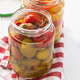 Pickled chili peppers in jar. - PhotoDune Item for Sale