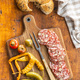 Sliced italian salami with hazelnuts, pickled chili peppers and pickles - PhotoDune Item for Sale