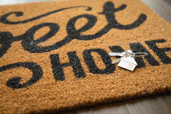 New House Keys and Keychain Rests on Home Sweet Home Welcome Mat - Stock Photo - Images