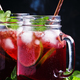 Frozen red tea with lime, ice and mint in glass jars - PhotoDune Item for Sale
