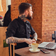 A man relaxing at the table after work with a laptop. - PhotoDune Item for Sale